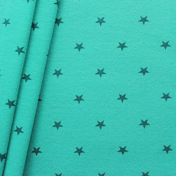 Türkisfarbene Bündchenware mit Sternen