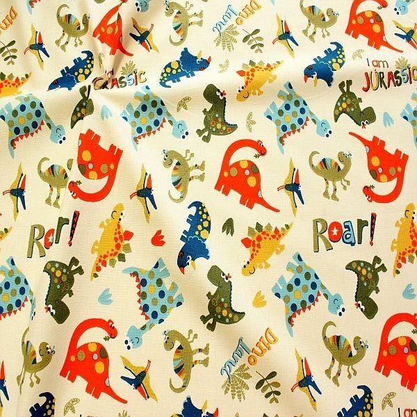 Baumwollstoff Dino Land Creme-Weiss